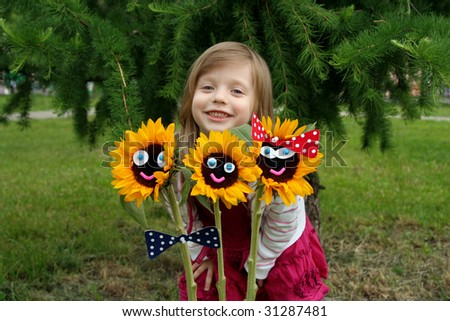 Smiling sunflowers as a happy family - stock photo