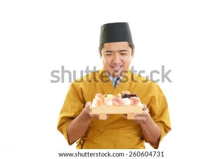 Smiling sushi chef - stock photo