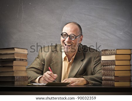 Smiling teacher in a classroom - stock photo