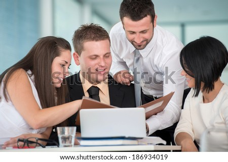 Smiling team of business people working together in company