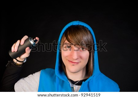 Smiling teen and his graffiti spray can