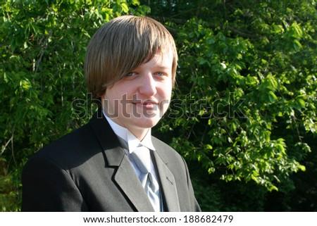 Smiling Teen Boy In Black Tuxedo Horizontal - stock photo