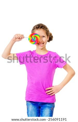 Smiling teen girl enjoys her huge lollipop. Studio shot. Isolated over white. - stock photo