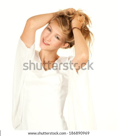 smiling teen girl looking at the camera, white background - stock photo