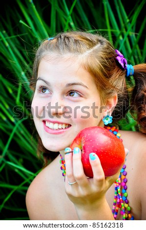 Smiling teen girl with big red apple