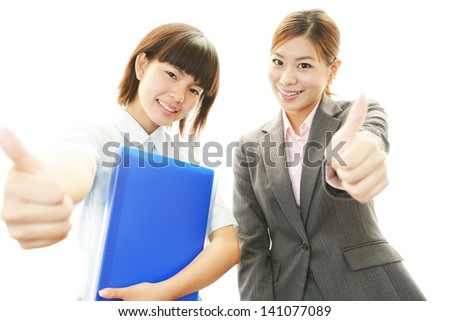 Smiling teen girl with teacher - stock photo