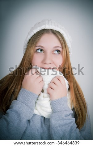 smiling teen with scarf