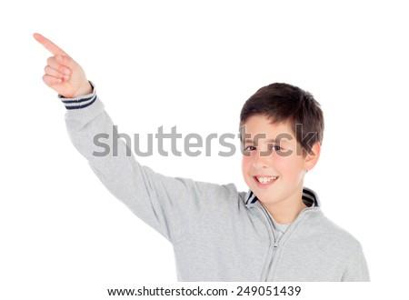Smiling teenage boy of thirteen indicating something isolated on white background - stock photo
