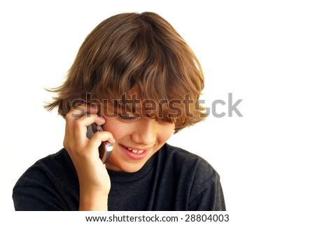 Smiling teenage boy talking on mobile phone isolated on white background. - stock photo