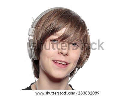 smiling teenage boy with headphones, isolated on white - stock photo