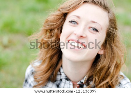 Smiling teenage girl had shot portrait - stock photo