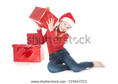 Smiling teenage girl in Santa's Helper hat holding big red gift over white