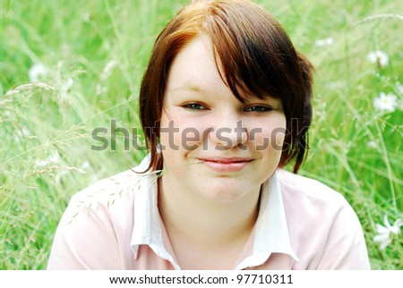 smiling teenage girl on a meadow