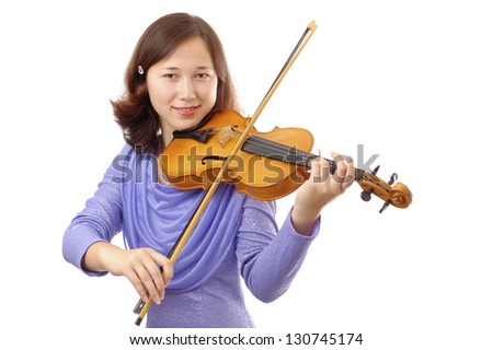 Smiling teenage girl playing the violin isolated on white background
