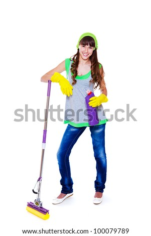 Smiling teenage girl standing with mop and cleanser - stock photo