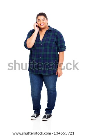smiling teenage girl talking on cell phone isolated on white - stock photo