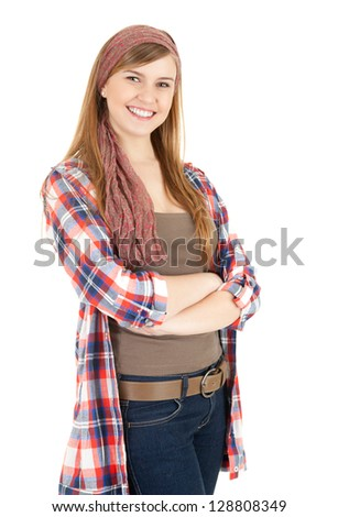 smiling teenage girl with folded arms, white background