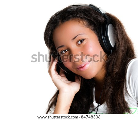 smiling teenage girl with headphones, listening to music with hand on head - isolated on white - stock photo
