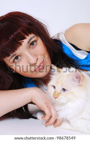 smiling teenage girl with her birman cat