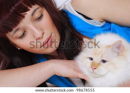 smiling teenage girl with her birman cat - stock photo