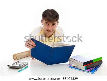 Smiling teenage student with textbooks and other materials.