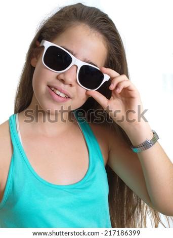 Smiling teenager girl wearing white rimmed sunglasses - stock photo