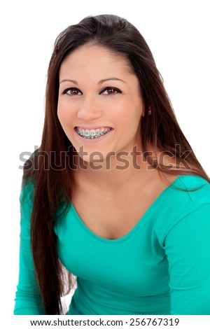 Smiling teenager girl with brackets isolated on a white background - stock photo