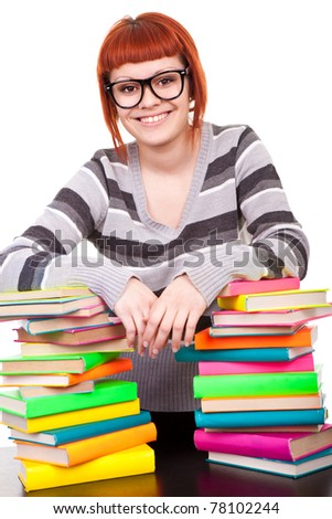 smiling teenager girl with stack of color books, isolated on white