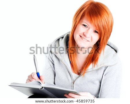 smiling teenager holding book over white