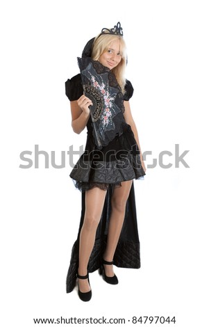 smiling teenager princess girl in long black velvet dress and crown