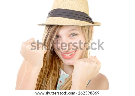 smiling teenager showing fists on white background