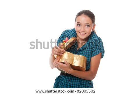 smiling teenager surprised with gift in hand over white background - stock photo