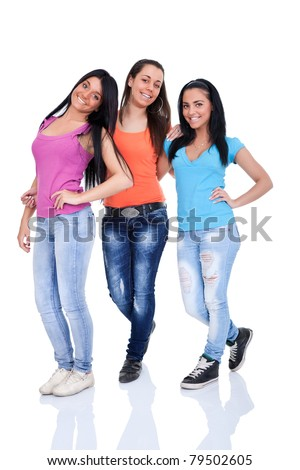 smiling teenagers girls posing on white background - stock photo