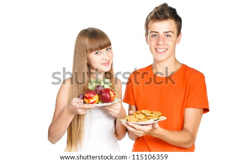 smiling teenagers shows a healthy  lunch isolated over white background - stock photo