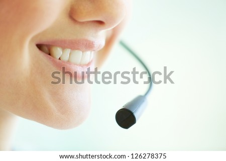 Smiling telemarketing operator giving a consultation concerning the product - stock photo