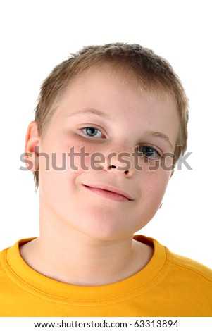 Smiling ten year old boy in yellow top isolated on white