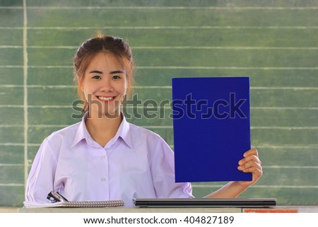 Smiling thai young women student in class - stock photo