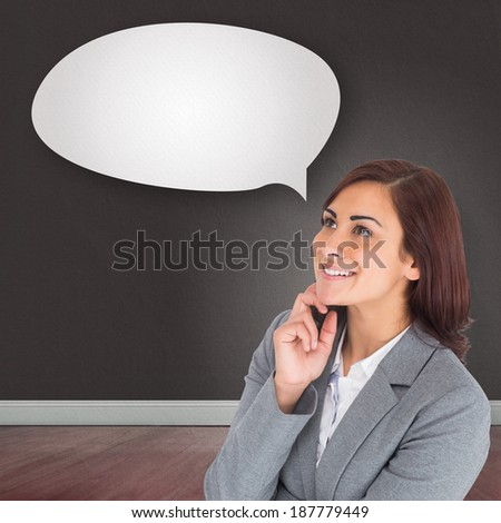 Smiling thoughtful businesswoman against speech bubble
