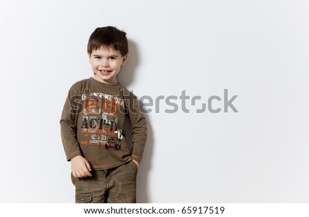 Smiling three year old boy studio portrait on background - stock photo