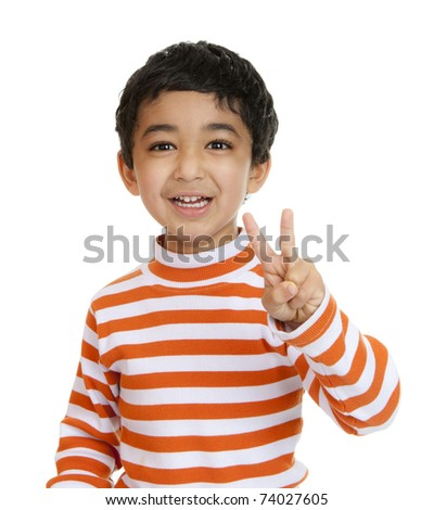 Smiling Toddler Flashes a Victory Sign, Isolated, White