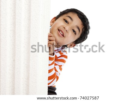 Smiling Toddler Peeks from Behind a Column, Isolated, White - stock photo