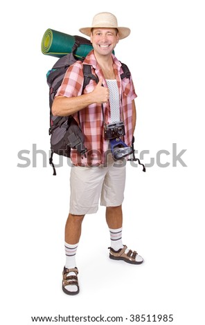 Smiling tourist with thumbs up against white background. Cheerful hiker with backpack isolated on white background. Successful traveler showing winning gesture thumb up. Happy tourist shows thumb up.
