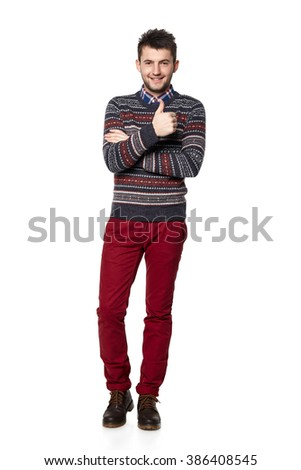 Smiling trendy casual man showing gesturing thumb up, over white background. - stock photo