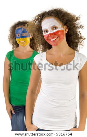 Smiling twins fans with painted Polish and  Slovakian flags on faces. They're looking at camera. Focus on first person. They're on white background. Front view. - stock photo