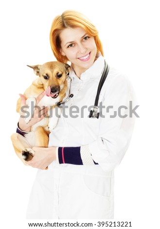 smiling veterinarian and puppy
