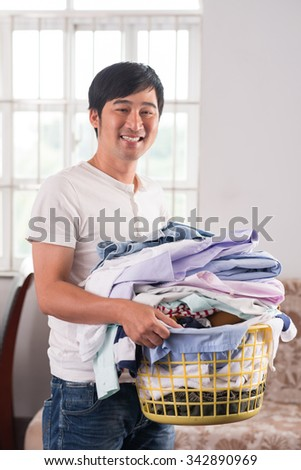 Smiling Vietnamese man with a basket of fresh linen