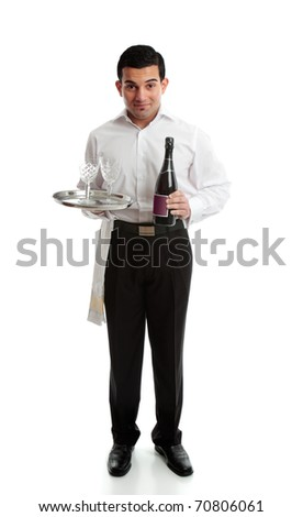 Smiling waiter, bartender or servant holding a bottle of  wine and glasses on a platter. - stock photo