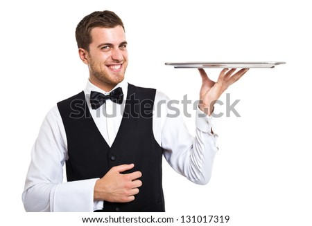 Smiling waiter holding an empty metal plate - stock photo