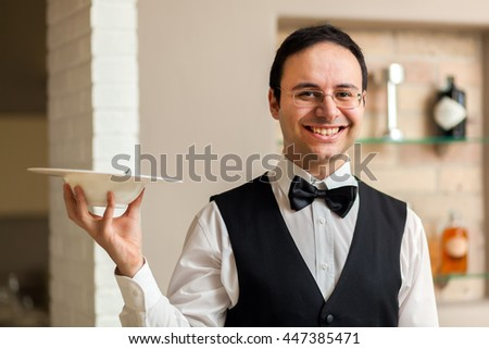 Smiling waiter portrait - stock photo