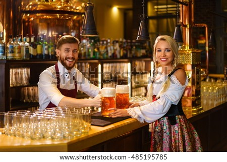 Smiling waitress and bartender at the counter